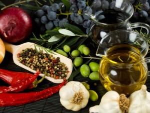 Extra virgin olive oil and balsamic vinegar with mediterranean food ingredients