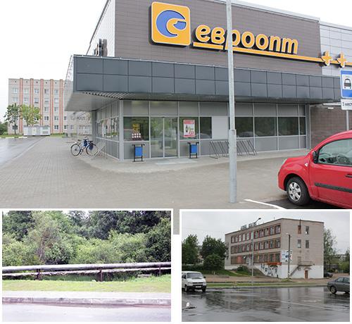 Вот такой контраст. Европейского вида супермаркет, слева от него местный дом быта, а спереди несколько симпатичных труб